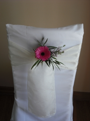 pink gerbera on white organza